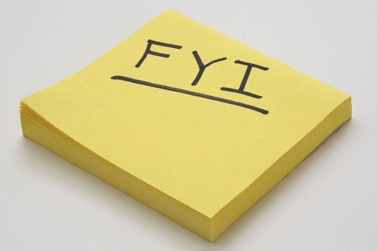 Yellow Pad of Post-It Notes with FYI written in black letters on the top sheet